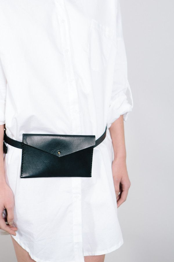 Black clutch on white dress-shirt //