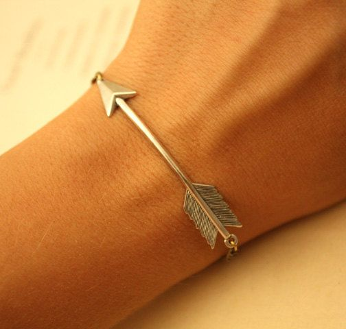 Want! It makes me think of the Hunger Games. Arrow bracelet.
