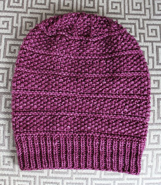 The Seeds & Purls Beanie Hat has beautiful details. The seed stitch provides a delicate texture. Plus, a few bands of purls add subtle definition to highlight the texture. Even the crown decreases add a beautiful touch. It's made with ultra soft superwash merino wool for a cozy feel. This pattern is easy to knit up, and will make a great gift or addition to your wardrobe.