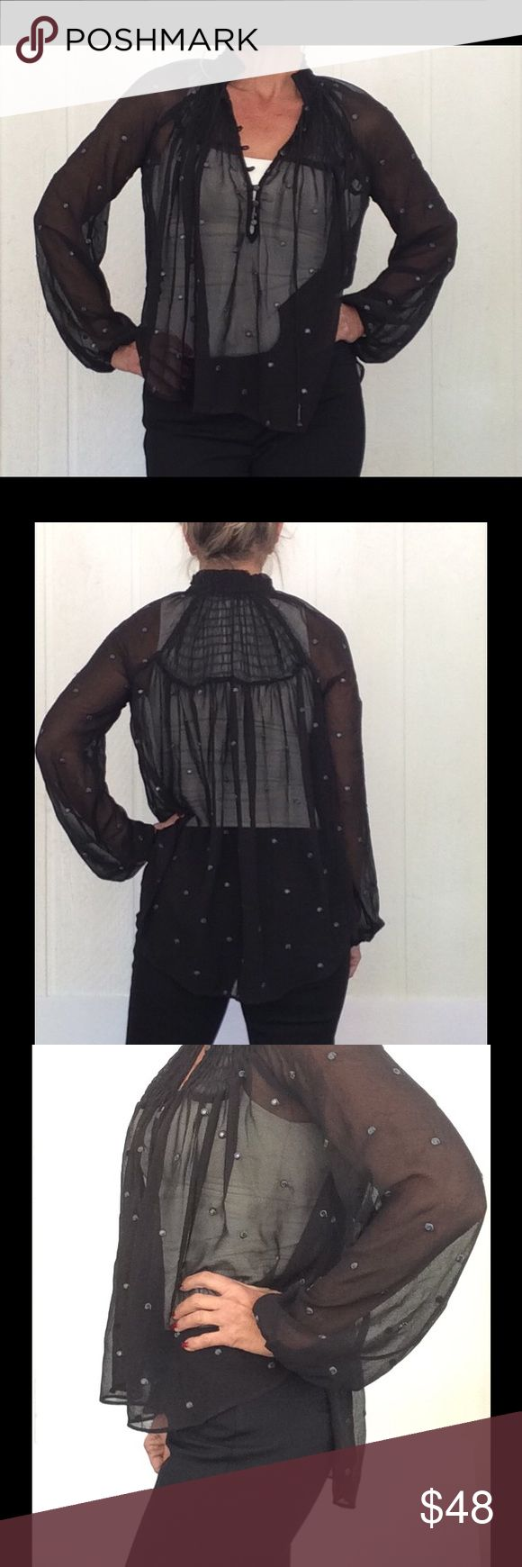 FREE PEOPLE BOHO CHIC SHEER BLACK TUNIC Flowy breezy sheer style. Perfectly paired with a camisole underneath. I wore white so you could see the detail and level of sheerness. Metallic thread dots with a sequin nested in the middle gives it a little extra sparkle. 8 metallic hook and d loop buttons at neckline with double tassle ties adorned with metallic beads at the end. Beautiful fit. No defects. Hi lo hem. Full sleeve with light elastic at cuffs. Gorgeous!  Size tag is missing but…