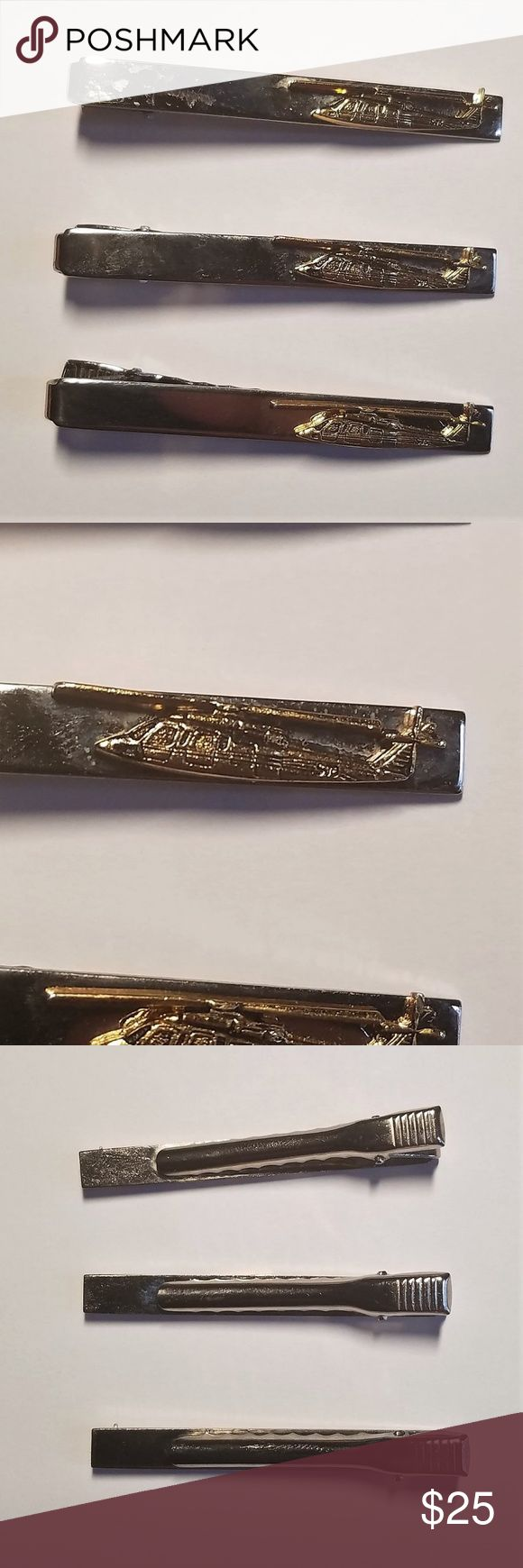 """Sikorsky Aircraft S76 Helicopter Tie Clip Lot of 3 Sikorsky Aircraft S-76 Military Helicopter Tie Clip Vintage - Lot of 3 *Excellent condition showing minimal wear. *The Sikorsky S-76 is an American medium-size commercial utility helicopter, manufactured by the Sikorsky Aircraft. The S-76 features twin turboshaft engines, four-bladed main and tail rotors and retractable landing gear. *Tie clip is in excellent condition showing minimal wear. *Length: 2 1/4 """" *Please examine all pictures in…"""