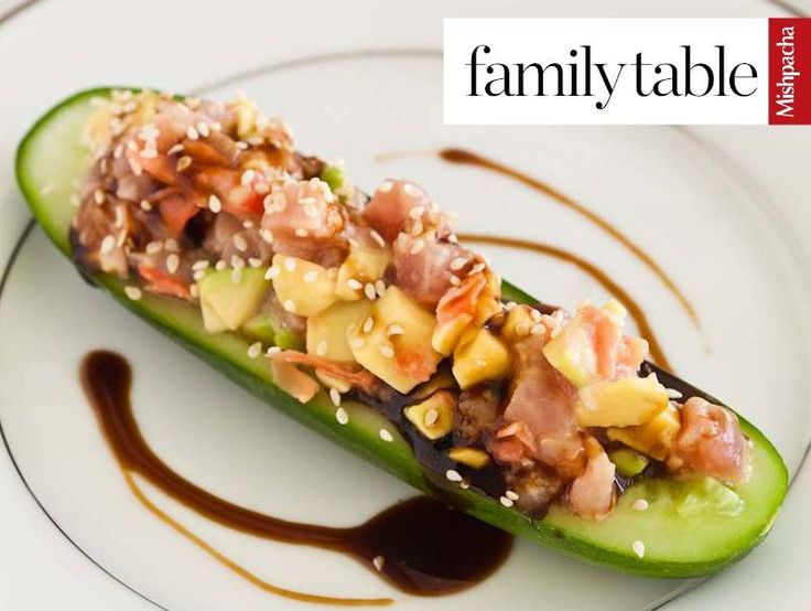 I've made this appetizer in so many different versions. I've served it with a raw tuna and salmon combination to a more daring crowd, but here I've given you a cooked tuna or salmon version. I like the way the cucumbers hold the dish together here, but I've also served it wit...