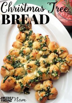 Tired of the same old dinner rolls at Christmas meal? This year, knock the socks off your friends and family with this impressive yet easy to make Christmas Tree Bread recipe. This pull-apart bread is loaded with ooey gooey cheese and coated with melted butter and fresh herbs to make a mouthwatering combination your guests won't be able to resist.