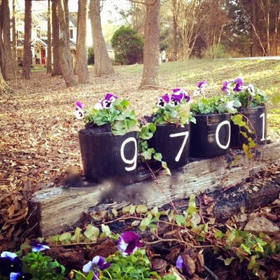 "House numbers on flower pots from ""A Blissful Spirit."""