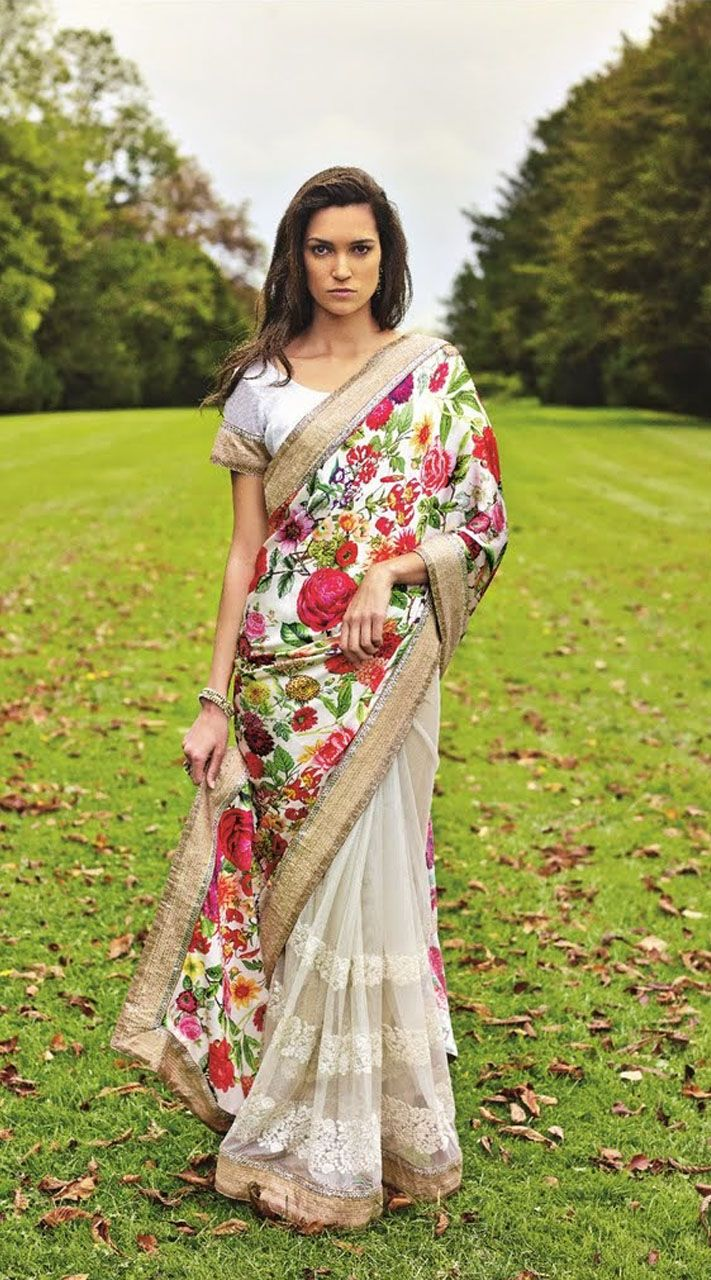 Classy white premium fabric half and half saree which is adorned with resham embroidery work on the first half in the horizontal panel, floral printed work on the pallu part and lace work on the border. Matching blouse piece attached with this attire. The blouse of this saree can be stitched in the maximum bust size of 42 inches.
