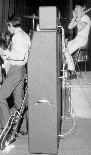 the who with RARE marshall 8x12 cabinet. check keith moon yelling to pete townsend!