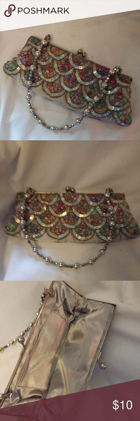 Sparkley clutch-multi-color with sequins Cute multi color clutch 9x4 inches.  Clean, no holes, cuts or stains.  I don't see any missing sparkles. Unknown Bags Clutches & Wristlets