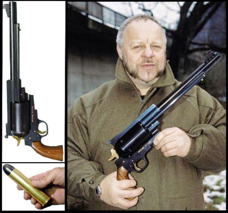 "Zeliska hand cannon (13 lbs/22"") fires .600 nitro express slug ($40 per round) its a handheld antiaircraft gun !!!"
