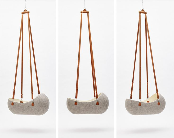 """This wool felt cradle makes the perfect little nest for baby - so what could be a more perfect name than """"Little Nest""""? Shaped out of one single piece of..."""