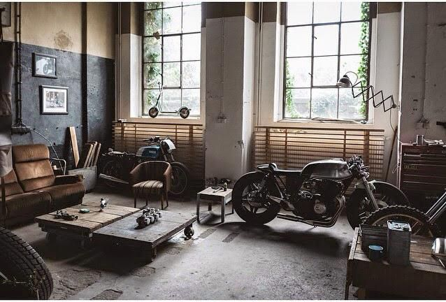 Reminds me of ghost riders loft.  Or Tom Hardy's in this means war bike mounted somewhere as decor.  Industrial. Urban I love it - Jaz