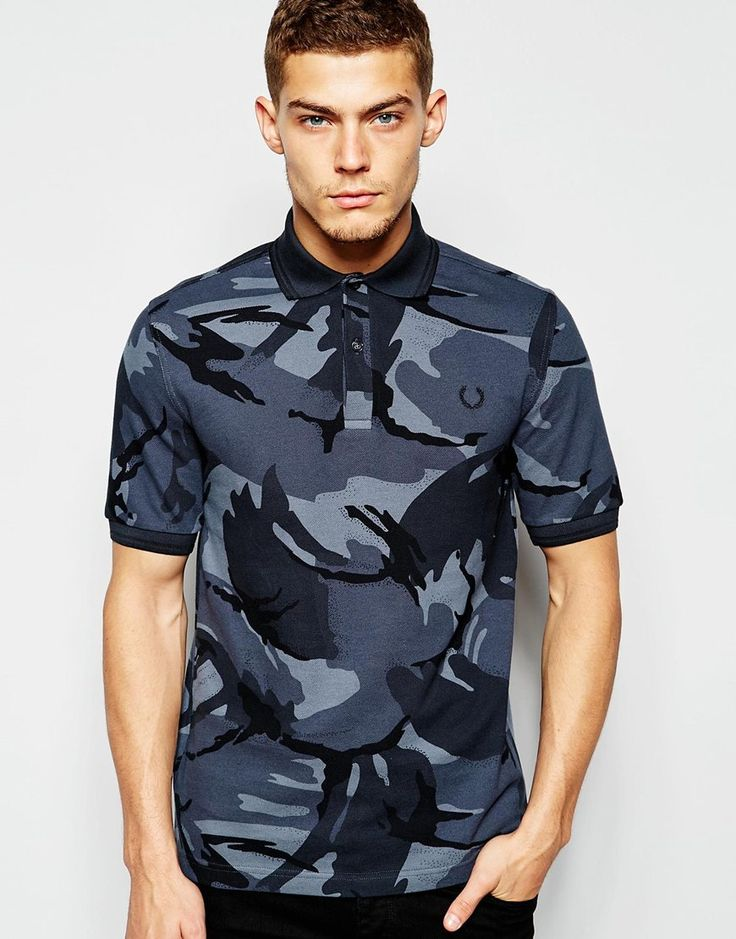 """Polo shirt by Fred Perry Laurel Wreath Collection Breathable pique All-over-print Polo collar Two button placket Embroidered logo Ribbed cuffs Regular fit - true to size Machine wash 100% Cotton Our model wears a size Medium and is 188cm/6'2"""" tall"""