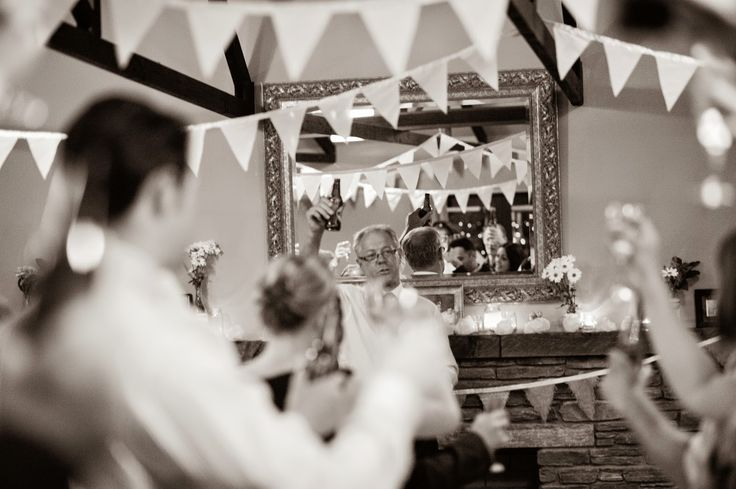 #rustic wedding reception with bunting, fairy lights, candles, burlap and garden flowers