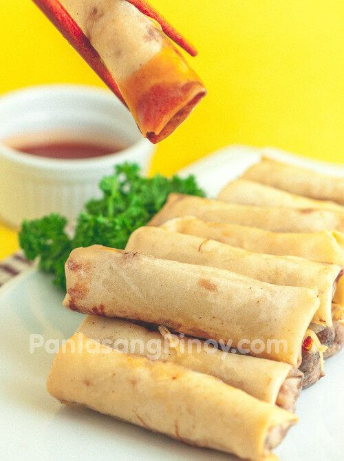Lumpiang Shanghai or Spring Rolls is a dish made-up of ground pork , vegetables, and spices with the mixture held together by beaten egg.