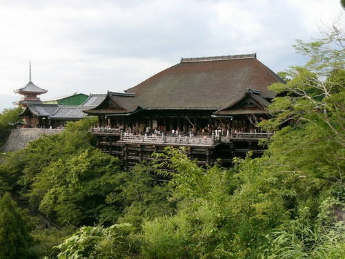 Architecture blends with nature at the Buddhist Kiyomizu Temple in Kyoto, Japan.