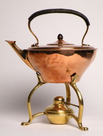 Tea kettle designed and manufactured by William Arthur Smith Benson between 1854 and 1924 and constructed using brass and copper. This piece is one of many that came out of the Arts and Crafts movement that demonstrated skilled crafted design.