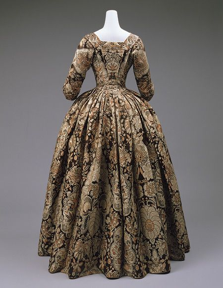 Dress, ca. 1735  British  Heavy silk with lace pattern design woven in beige and rust on a dark brown satin ground