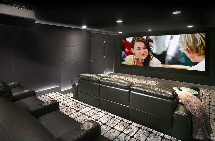 This Home Theater in Seattle, started with a goal to create a no-compromise experience. The front speakers and dual 15″ subwoofers are concealed behind the 130″ widescreen. Surround speakers are in-wall models that are hidden behind accoustical fabric. The charcoal color scheme allows the room to disappear when the lights are down, bringing the screen to life. In the utility room, a rack hides most of the components, while the frequently used components are are cleverly hidden to the left of…