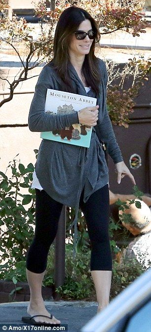 Essential reading material: Sandra was spotted holding a copy of children's book Mouseton Abbey