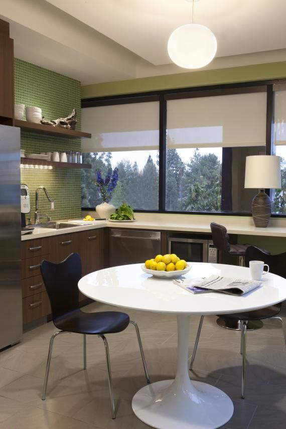 The staff break room features a small, efficient kitchen with built-in bar seating at the window, a small dinette table, and lounge seating (not shown) to allow employees to have multiple seating options in a small space. Photo: Lisa Romerein