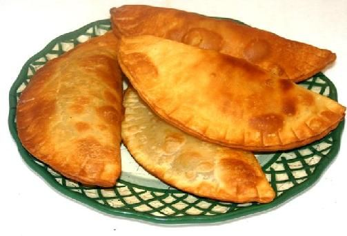 NeverSeconds: Puerto Rican Empanadas. Store bought empanada wrappers and recaito? Nice.