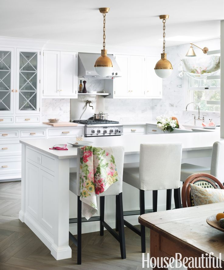 Touches of brass in this New Jersey kitchen designed by Caitlin Wilson: Hicks pendants from Circa Lighting, Boston Functional sconce by Visual Comfort, and Prestige Brass hardware. Henriksdal barstools by Ikea. Silestone countertops in Lagoon have the look of marble but are impervious to stains.   - HouseBeautiful.com