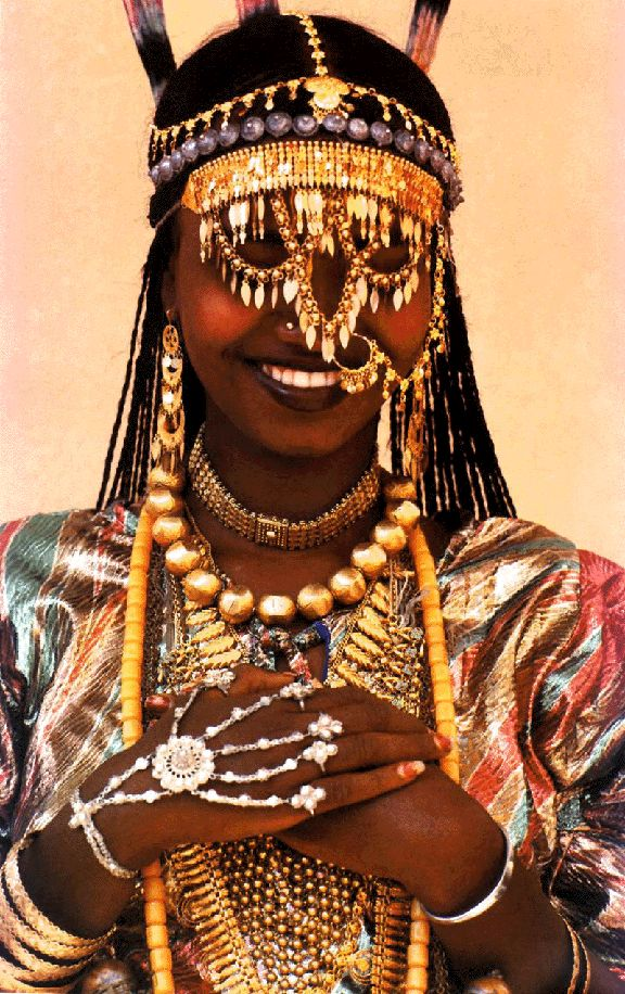 """(India, these are your """"African roots"""" and this is where this custom comes from) Ethiopian Karo tribe woman - Many tribes in the Mediteraninan and Middle East wore/wear  all their Dowry as jewelry and is worn almost all the time..therefore always having it with them. It was an advertisement as to whether she had a rich family or not, making her more desirable. And, of course, as an adornment to enhance their beauty."""