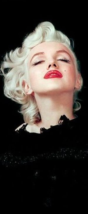 Marilyn. Black cape sitting. Photo by Milton Greene, 1955.