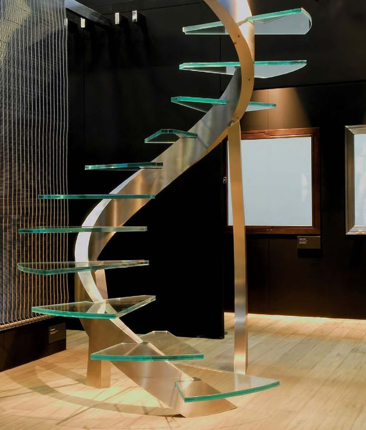 A really modern look for a super chic and contemporary home, this staircase is filled with slick beauty and impressive designs. Although it's not the most family-friendly, or the most safe, it sure brings a lot of sass and elegance into an otherwise more bare space. The glass stairs will have to be cleaned more than other materials, but they sure are pretty!