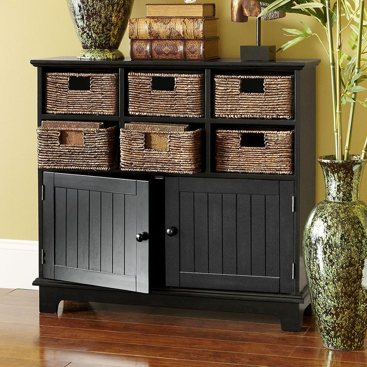 Pier 1's Holtom Cabinet offers a handsome way to get organized, with removable rattan baskets and plenty of room underneath.