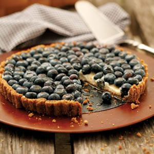 For this tart a few tablespoons of maple syrup sweeten the blueberry topping and round out the flavor of the cream filling.