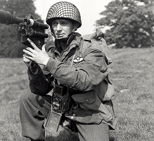 Sgt. E.R. Bonter with a rare fast telephoto. Such equipment was in short supply, LAC PA#137025
