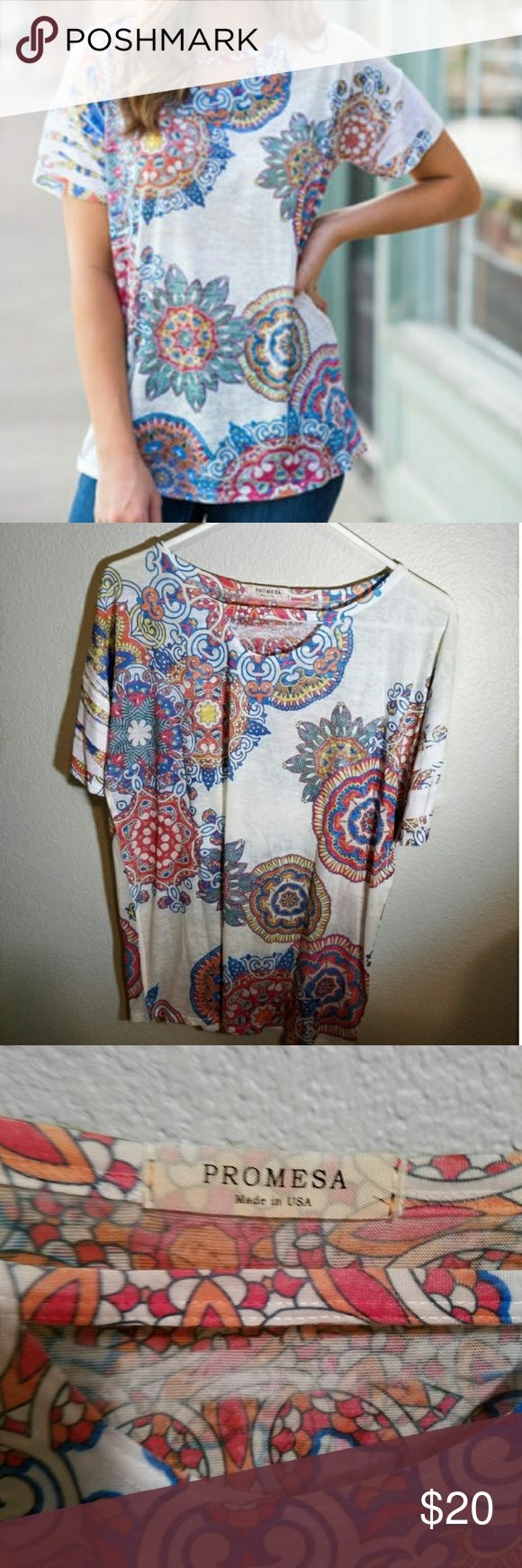 SALE NWOT Large Promesa medallion tee This is a large boho tee by Promesa with a colorful kaleidoscope or medallion design. New without tags. I purchased it from an online boutique. 70% polyester, 30% rayon. Made in USA. Promesa Tops Tees - Short Sleeve
