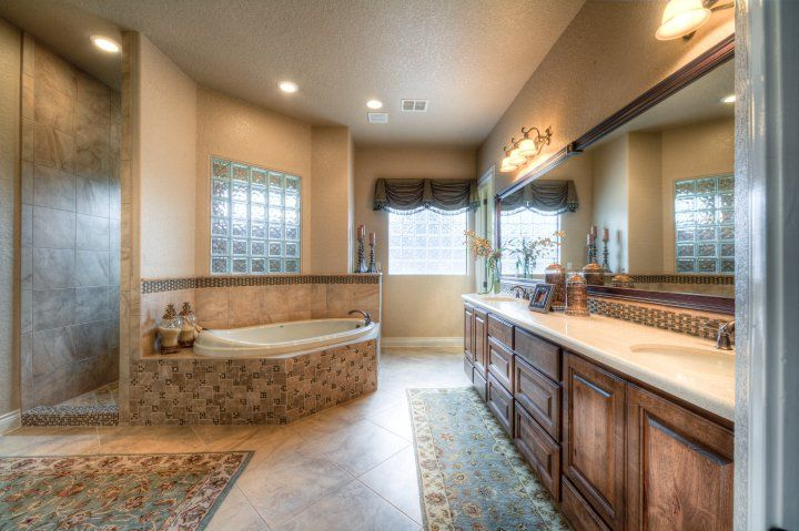 Lightly Decorated Master Bath With Plenty Of Open Space