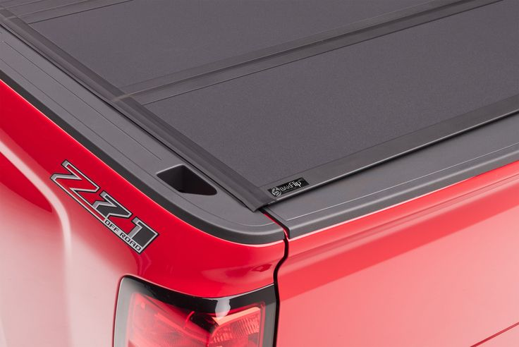 If you are looking for a 2004-2015 Nissan Titan hard folding tonneau cover that literally does it all, the BAKFlip MX4 from BAK Industries is it. From its sleek contemporary styling to its state of the art function, the BAKFlip MX4 hard folding heavy-duty truck bed cover has been enhanced with a premium density foam core, upgraded latch housing components, and an all-new integrated tailgate seal that allows the tailgate to be closed with the cover up or down. Made in the USA!