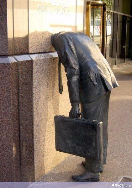 What a strange sculpture! I like it because it I think it conveys a strong feeling, one of despair and hopelessness at having to go to work.