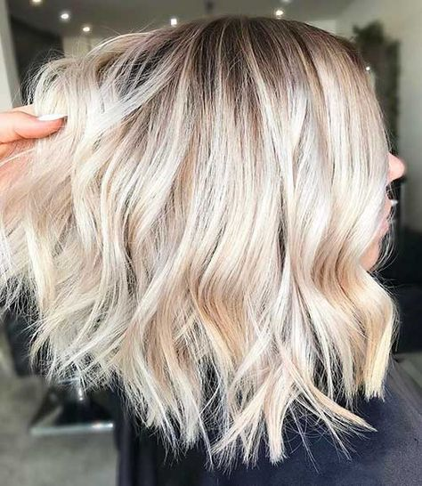 Short Beachy Wavy Hairstyle Here is a long bob hairstyle with platinum blonde ombre color and dark roots, it is styled into beach waves too emphasize the modern style.