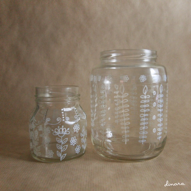 cute jars with white painted decoration