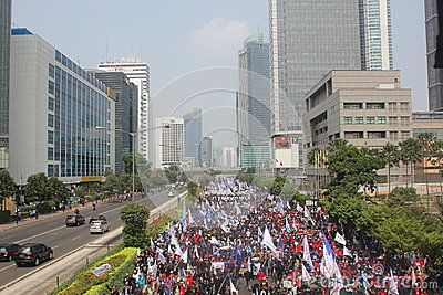 Thousands of workers held marched to protest against low wages in Jakarta, on July 12, 2012.