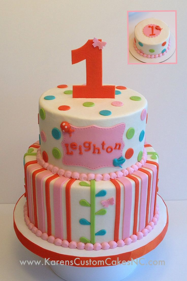 1st birthday and smash cake made to match party decor. Pink, orange, green and blue. Buttercream w fondant decor.