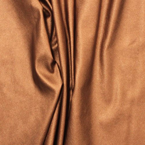 Metallic Copper Matte Faux Vegan Leather Fabric - Sparkle metallic copper colour poly spandex blend faux vegan leather.  Fabric has a matte sparkle textured small pebble surface on the front, and a soft spandex knit backing in a cream colour.  This is a medium weight with a small mechanical stretch.  Great for apparel, accessories, and more!  ::  £16.96