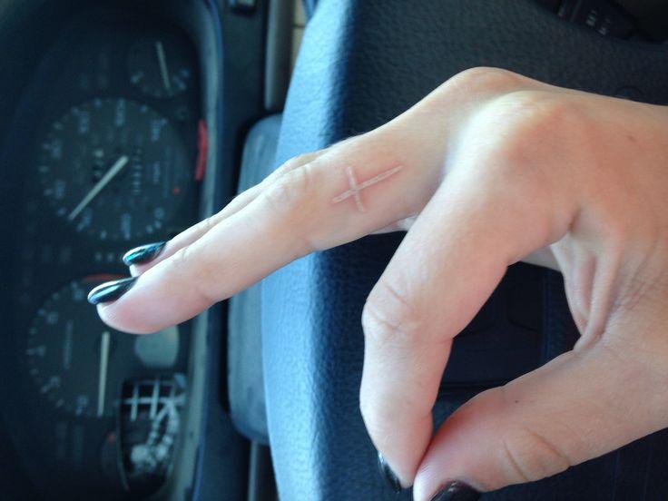 My white ink finger cross tattoo