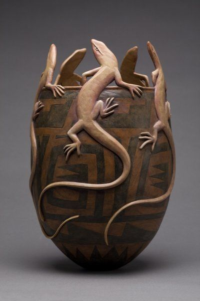 """Voices From the Rim by Ron Layport, 2008. Wood carving, H: 12in. W: 7.75in. D: 7.75in.   """"From canyon rims of the Colorado and throughout the Rio Grande Basin, come voices of ancient makers, so powerful that one can experience a thousand years of humankind. I seek to add my voice to this ongoing dialogue."""" ~Ron Layport"""