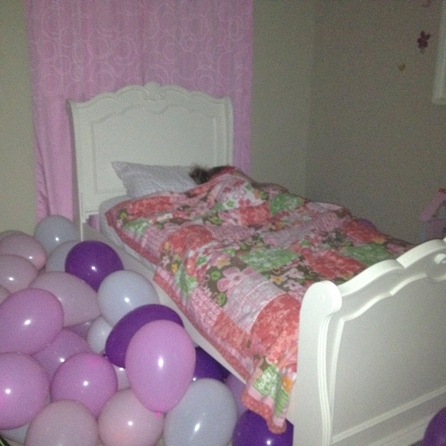 """The sleeping birthday girl! Her room """"magically"""" filled up with balloons overnight! She was so excited when she woke up the next morning!"""
