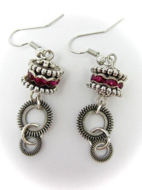 One-of-a-Kind Handcrafted Jewelry Created with Recycled Vintage Watch Parts and Found Objects These earrings are created using real vintage pocket watch gears. They are 2 inch in length from the bottom of the earring and are embellished with real Swarovski crystals in Ruby. These are a