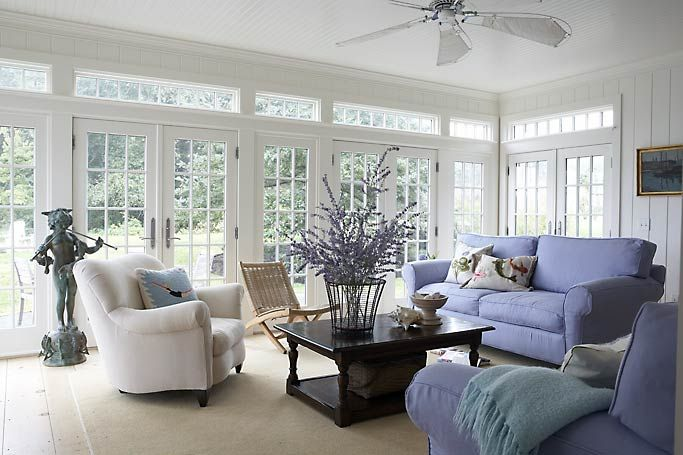 Wall of floor to ceiling windows and french doors in back porch
