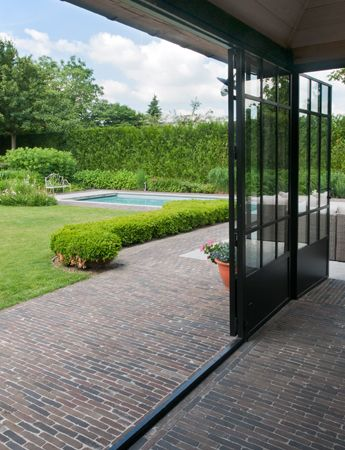 Authentic clay pavers provide a seamless transition between the interior and the exterior