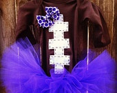 Football baby onesie and tutu With matching hair bow in sizes 0-3mo, 3-6mo, 6-12mo, or 24mo. $35.00, via Etsy.