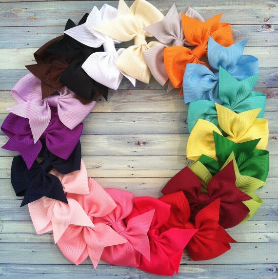 I found this listing on Pinterest for 20 hair bows for $40 and the way they displayed the bows got me thinking... You could buy one of those wire wreath forms for two bucks and arrange the bows like this so that it isn't just bow storage but decoration in a little girl's room. It would make a beautiful gift, too!