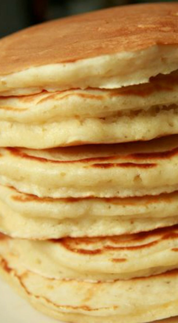 Alton Brown's Buttermilk Pancakes ~ These pancakes are awesome. Fluffy and light... Best pancakes EVER - You'll never go back to another pancake recipe. #fluffybuttermilkpancakesrecipe #bestbuttermilkpancakesrecipe