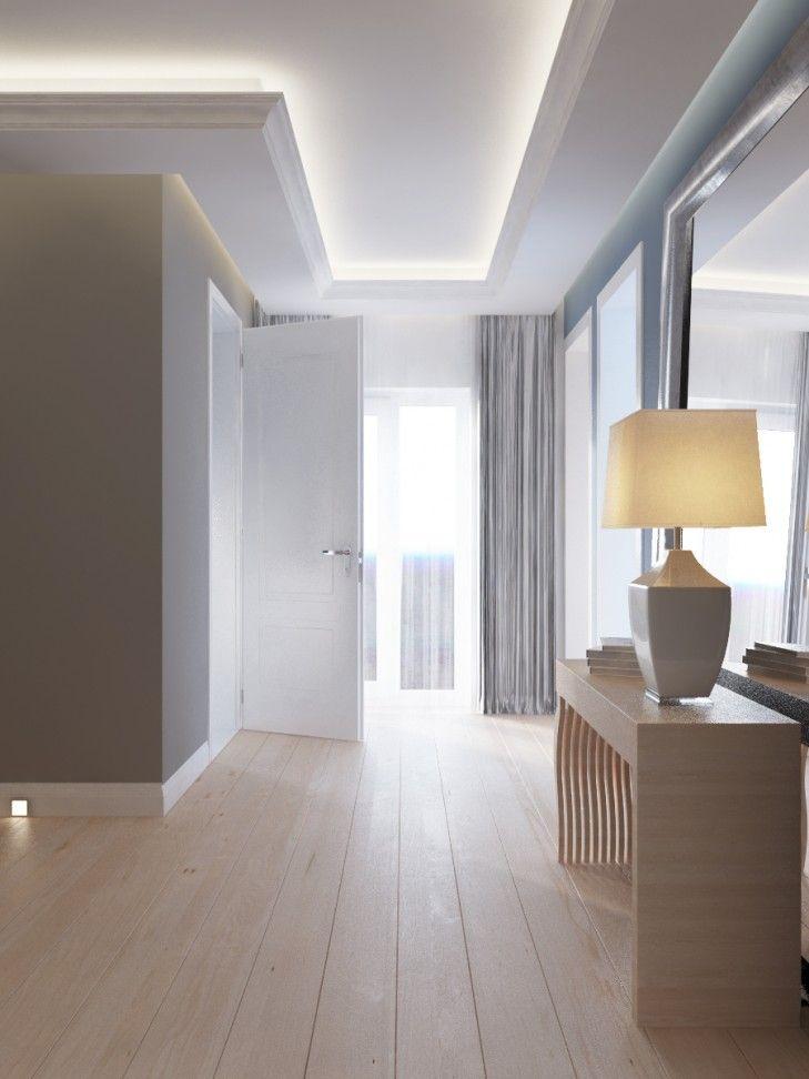 Projekt wnętrza przestronnego holu zakończonego dużym oknem. Klasyczna konsolka z jasnego drewna usytuowana jest na osi klatki schodowej i dopełnia jej widok.